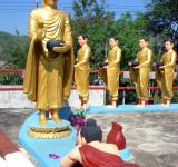 Free Photo - Buddha and followers receiving offering from a devotee