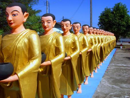 Line of Buddhist monk statues - Free Stock Photo