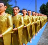 Free Photo - Line of Buddhist monk statues