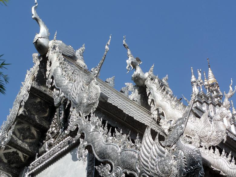 Free Stock Photo of Ornate silvered Buddhist temple roof Created by Chas Mac