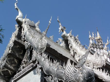 Ornate silvered Buddhist temple roof - Free Stock Photo