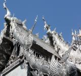 Free Photo - Ornate silvered Buddhist temple roof