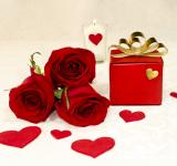 Free Photo - Three red roses and a gift