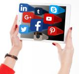 Free Photo - Woman Holding Tablet with Social Media Networks Logos