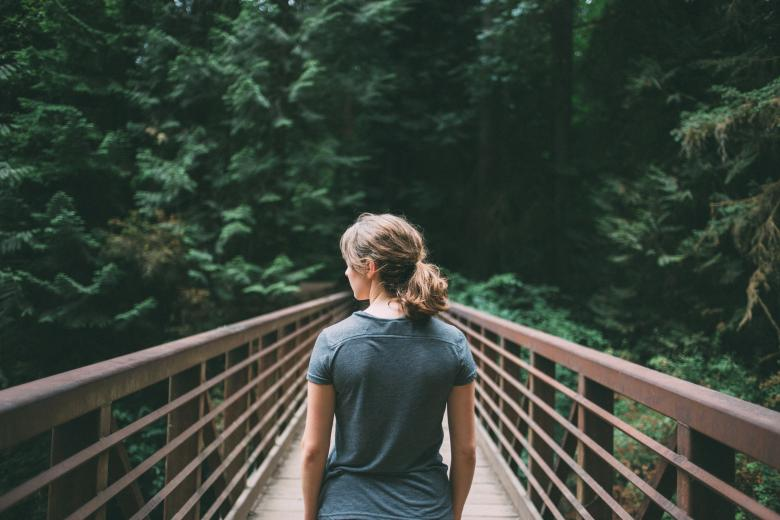 Free Stock Photo of Girl on Bridge Created by Unsplash