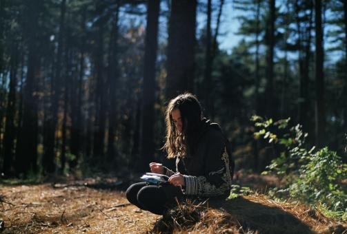 Writer in the Woods - Free Stock Photo
