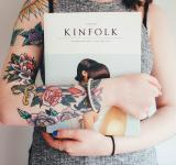 Free Photo - Tattooed girl holding a book