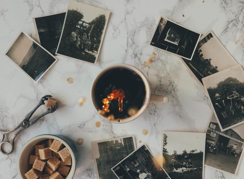 Free Stock Photo of Coffee and Old Photographs