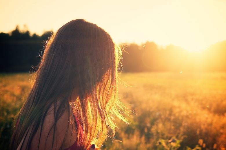 Free Stock Photo of Girl in Sunshine Created by Unsplash