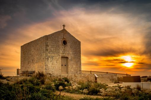 Sunset behind an old church - Free Stock Photo
