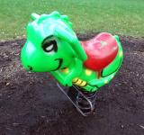 Free Photo - Green playground rocking dinosaur