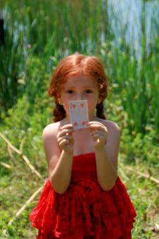 Girl holding a Card - Free Stock Photo