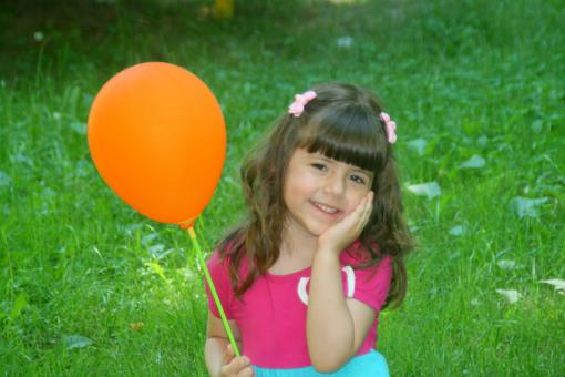 Girl holding a Balloon - Free Stock Photo