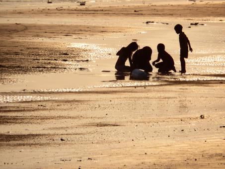 Family Plays on the Beach Silhouette - Free Stock Photo