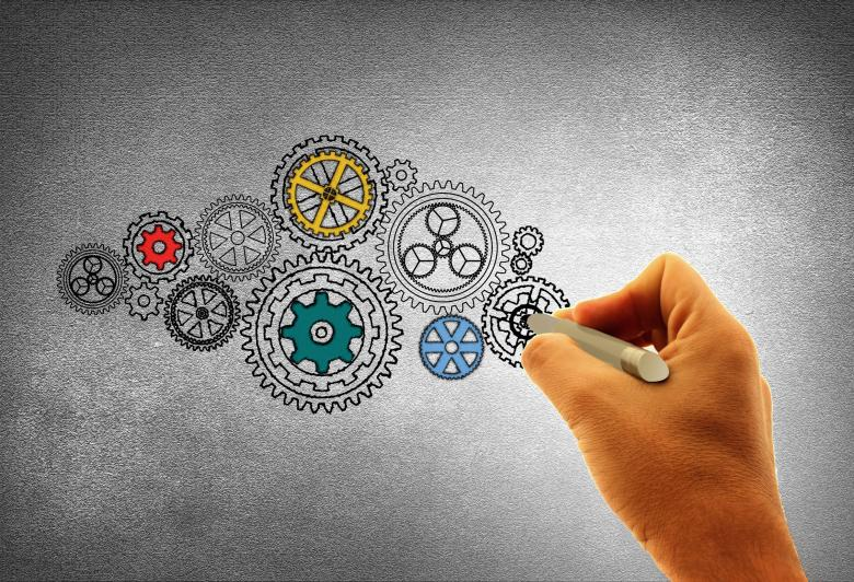 Free Stock Photo of Concept of Work - A Person Drawing Cogwheels Created by Jack Moreh