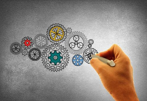 Concept of Work - A Person Drawing Cogwheels - Free Stock Photo