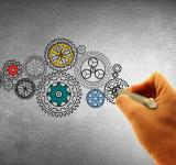 Free Photo - Concept of Work - A Person Drawing Cogwheels