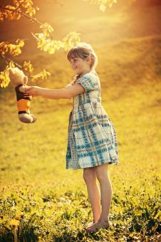 Girl with her Toy - Free Stock Photo