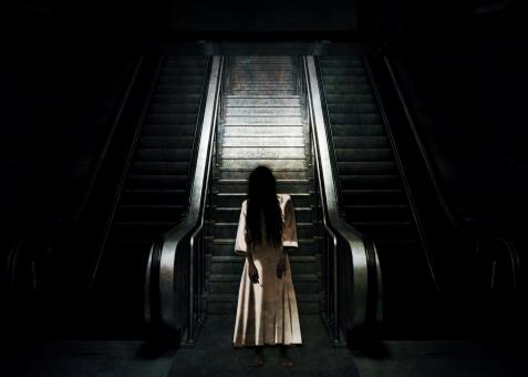 Ghost by the Escalator - Free Stock Photo