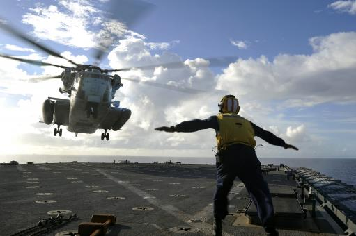 Sailor Directing Helicopter - Free Stock Photo
