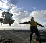 Free Photo - Sailor Directing Helicopter