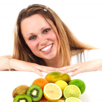 Eat More Fruit - Woman and Assorted Fruit - Free Stock Photo