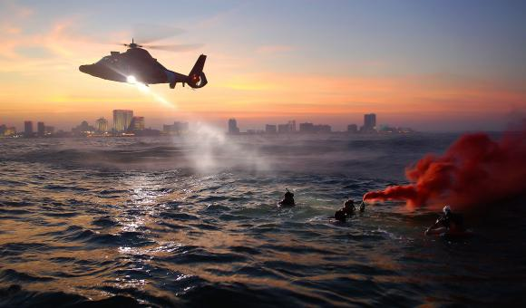 Helicopter flying over the Sea - Free Stock Photo