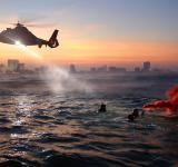Free Photo - Helicopter flying over the Sea