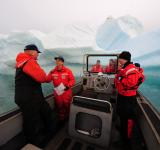 Free Photo - Sailors near a Giant Iceberg
