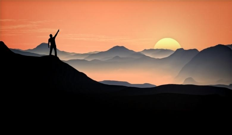 Man Raising Arm at the Top of the Mountain Free Photo