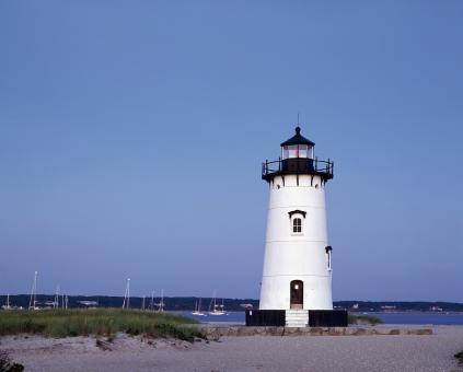 Lighthouse on the Shore - Free Stock Photo