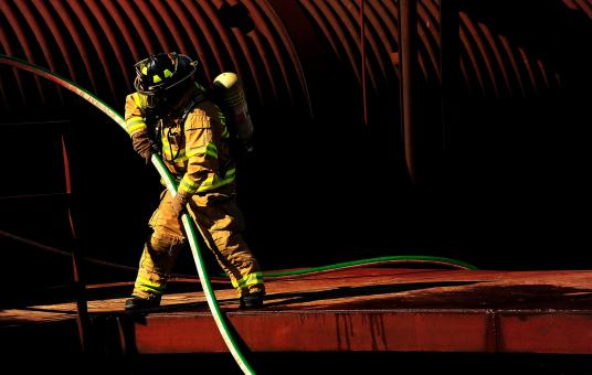Firefighter with the Waterpipe - Free Stock Photo