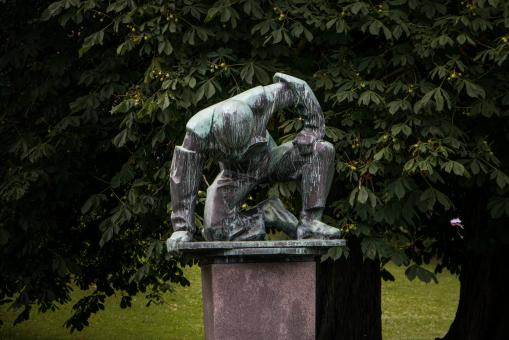 A sculpture of tired or humble man - Free Stock Photo