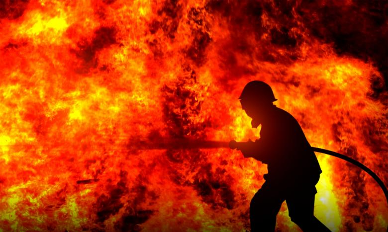 Firefighter Fighting a Raging Wildfire - Free Fire Stock Photos