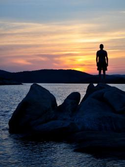 Hiker on the Rocks by the Lake - Free Stock Photo