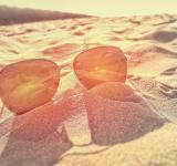 Free Photo - Sunglasses on the Sand at Sunset