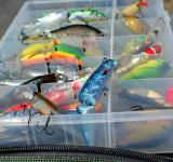 Free Photo - Box with lures lies on the fishing bag