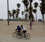 Free Photo - Biking on the Beach