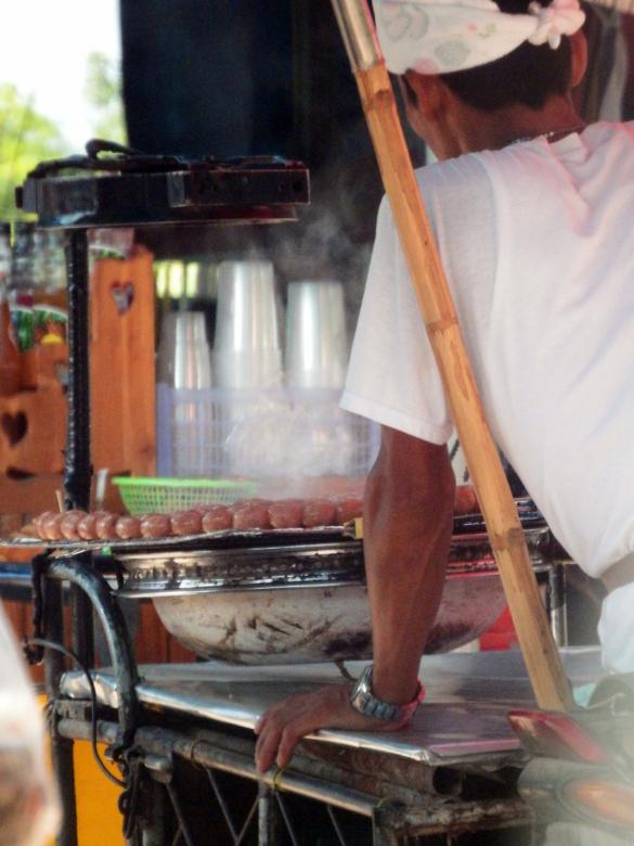 Free stock image of Street Vendor Cooking Sausages created by Ivan