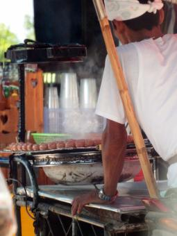 Street Vendor Cooking Sausages - Free Stock Photo
