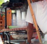 Free Photo - Street Vendor Cooking Sausages