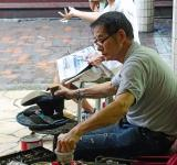Free Photo - Cobbler on the Street