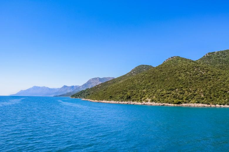 Free Stock Photo of Croatian coastline with blue water and hills Created by invisiblepower