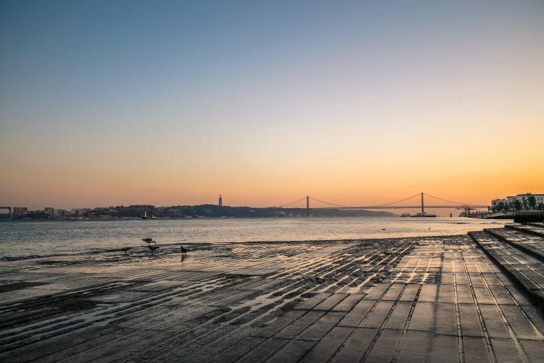 Free Stock Photo of Lisbon river side at sunset Created by invisiblepower