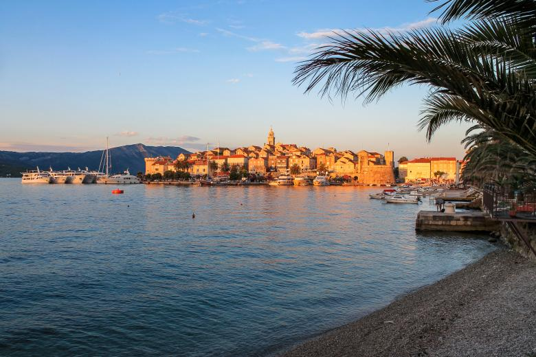 Free Stock Photo of Medieval Town at Sunset with Palm Trees and Beach Created by invisiblepower