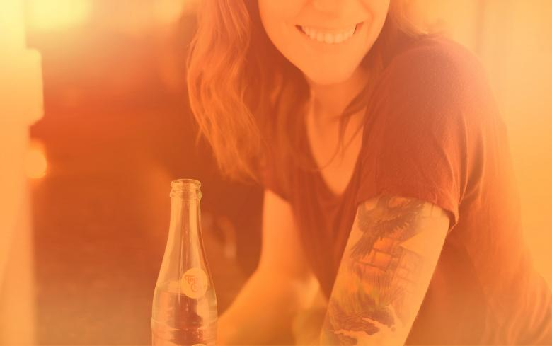 Free Stock Photo of Woman with Drink Smiling - Colorized Hazy Effect Created by Jack Moreh