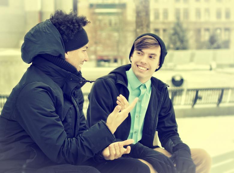 Two Friends Talking and Having Fun - Free Urban Stock Photos