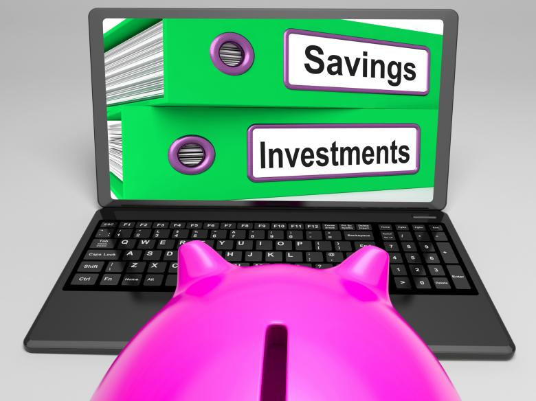 Free Stock Photo of Savings And Investments Files On Laptop Showing Finances Created by Stuart Miles
