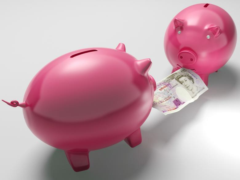 Free Stock Photo of Piggybanks Fighting Over Money Shows Investment Decisions Created by Stuart Miles