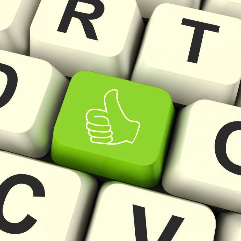 Thumbs Up Computer Key Showing Approval And Being A Fan Free Stock